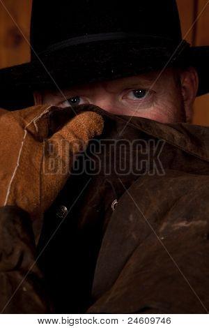 Cowboy Looking Over Coat