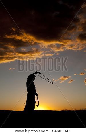 Cowboy Silhouette Twirling Rope