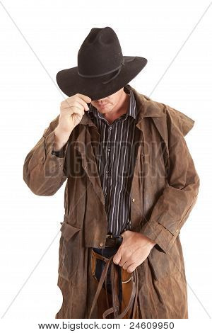 Cowboy With Duster Holding Hat