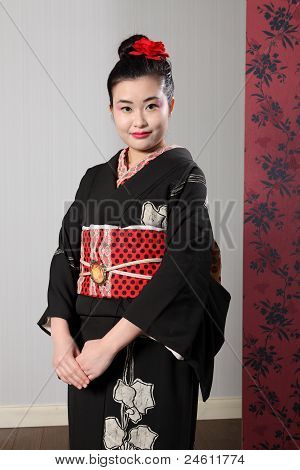 Oriental Woman In Black Japanese Kimono Robe Dress