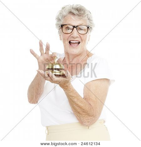 portrait of senior woman pressing a hotel bell over white