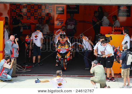 SEPANG, MALAYSIA - OCTOBER 21: MotoGP rider Casey Stoner leaves the garage for a free practice ride on Day 1 of the Malaysian Motorcycle GP 2011 on October 21, 2011 at Sepang, Malaysia.
