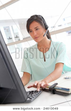 Portrait of beautiful nurse with headset on
