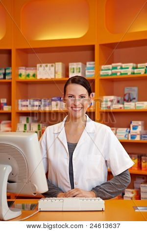 Pharmacist At Counter In Drugstore