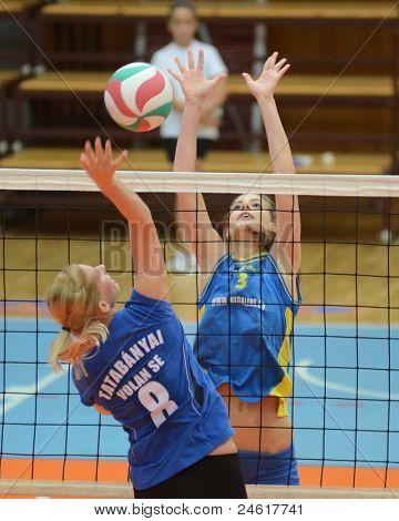 KAPOSVAR, HUNGARY - OCTOBER 2: Zsofia Harmath (R) in action at a Hungarian NB I. League volleyball game Kaposvar (yellow number) vs Tatabanya (white number), October 2, 2011 in Kaposvar, Hungary.