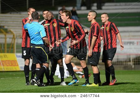 KAPOSVAR, HUNGARY - OCTOBER 15: Honved players complain to the referee at a Hungarian National Championship soccer game - Kaposvar (white) vs Honved (red) on October 15, 2011 in Kaposvar, Hungary.
