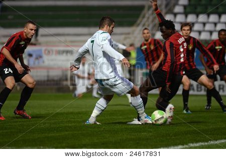 KAPOSVAR, HUNGARY - OCTOBER 15: Boris Gujic (white 7) in action a Hungarian National Championship soccer game - Kaposvar (white) vs Honved (red) on October 15, 2011 in Kaposvar, Hungary.
