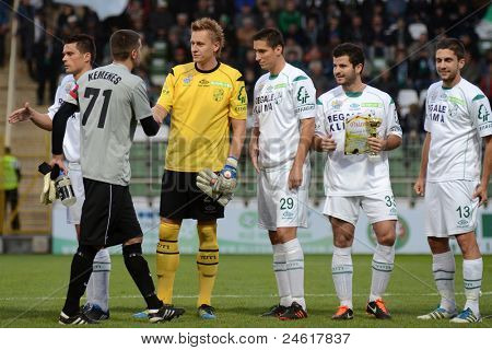 KAPOSVAR, HUNGARY - OCTOBER 15:Competitors shake hands before a Hungarian National Championship soccer game - Kaposvar (white) vs Honved (red) on October 15, 2011 in Kaposvar, Hungary.