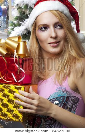 Christmas. Woman In Santa Claus Hat