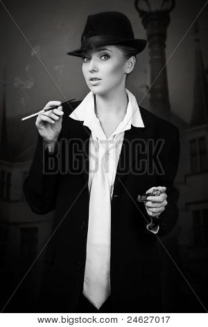 Attractive Woman Smoking On The Night City Street