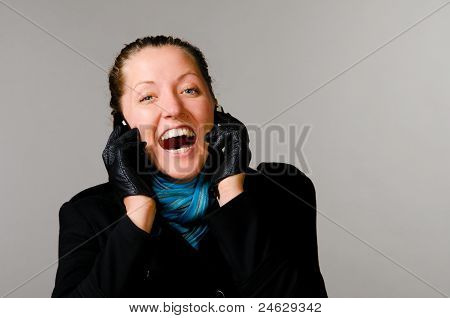 woman with two mobile phones