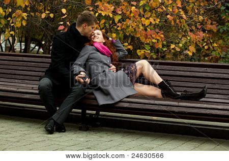 Young Love Couple On A Park Bench