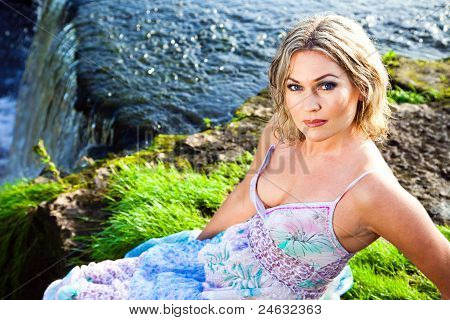 Beautiful Girl On Brink Of Precipice Of River Waterfalls