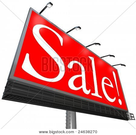 The word Sale on a red background on an outdoor billboard sign advertisement to attract customers to a special discount event at a store