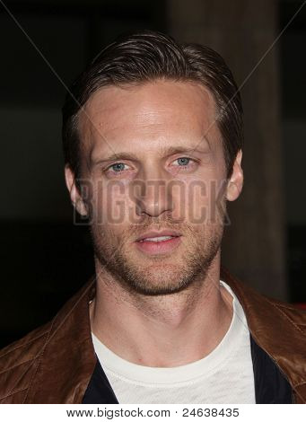 """LOS ANGELES - JAN 16:  Teddy Sears arrives to the """"American Horror Story"""" Los Angeles Premiere  on October 3,2011 in Hollywood, CA"""