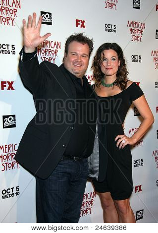 """LOS ANGELES - OCT 3:  Eric Stonestreet & Date arrives to the """"American Horror Story"""" Los Angeles Premiere  on October 3,2011 in Hollywood, CA"""