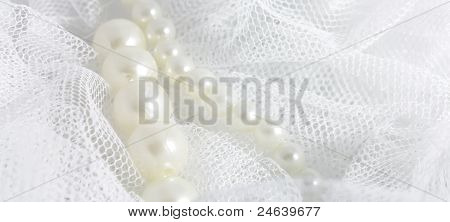 pearl and soft white fabric
