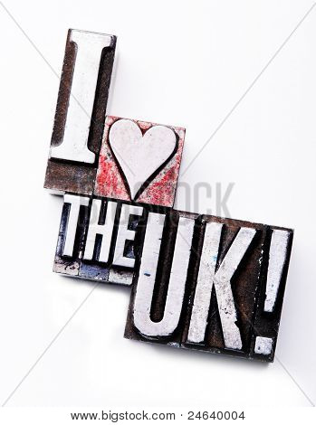 "The phrase ""I Love The UK"" in letterpress type. Cross processed, narrow focus."