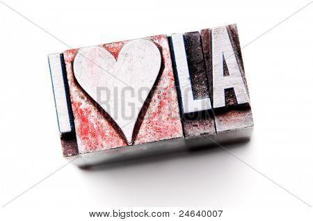 "The phrase ""I Love LA"" in letterpress type. Cross processed, narrow focus."