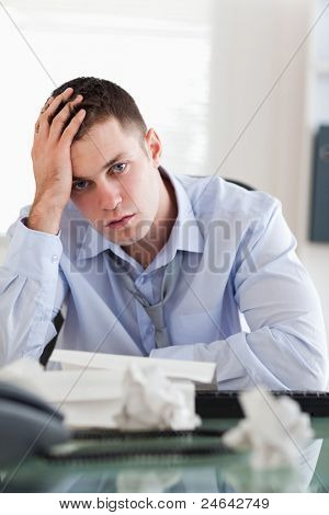 Close up of frustrated businessman being overextended with his accounting