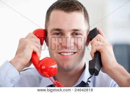 Close up businessman handling the telephone stress smiling