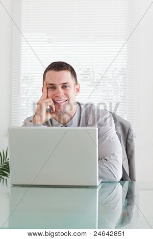 Close up of young businessman getting good news via email