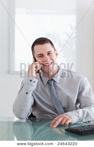 Smiling happy businessman listening to caller