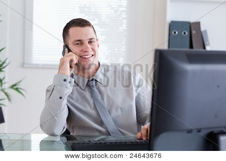 Smiling happy businessman getting pleasant call