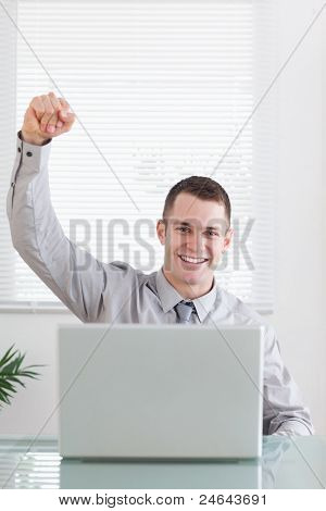Close up of young businessman getting awesome news via email