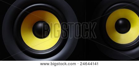 Parts of a two yellow modern subwoofers