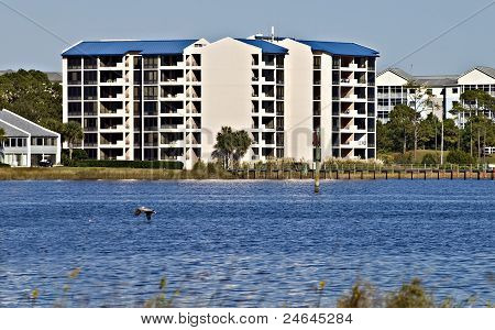Condominiums Along The Shore Of The Ocean