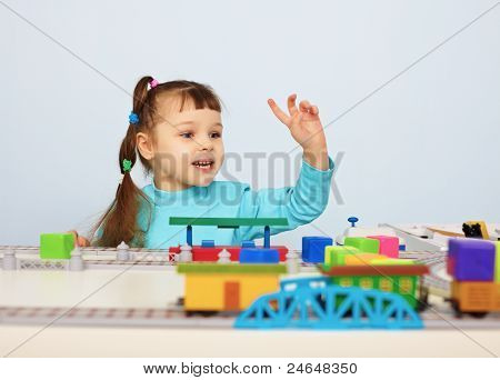 Child Plays With A Toy Railroad