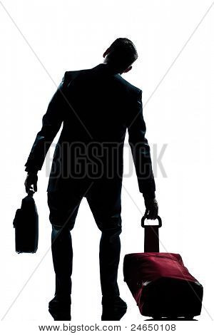 rear view one caucasian business traveler man tired with suitcase  full length silhouette in studio isolated white background