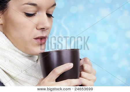 Young Woman With Hot Beverage