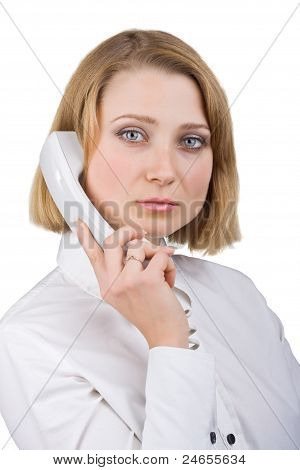 Business Woman In A White Blouse With A Telephone Receiver In Hand