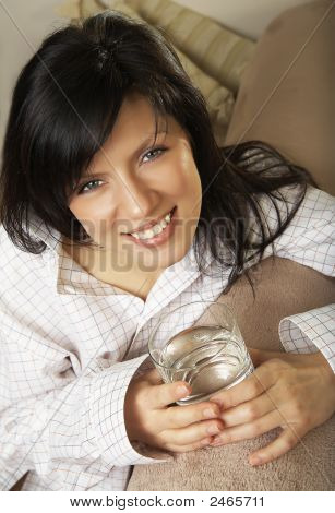 Young Beautiful Woman With Glass Of Mineral Water