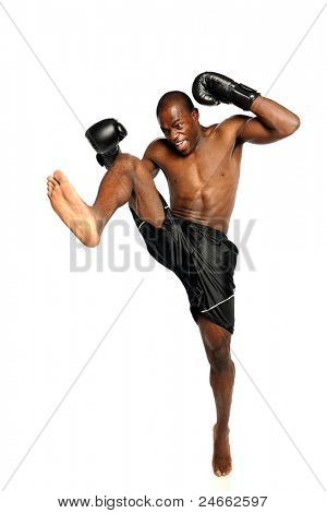 Extreme Fighting Athete kicking isolated on a white background