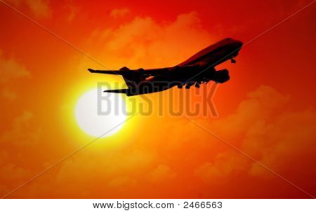 Jet Flying In Sunset