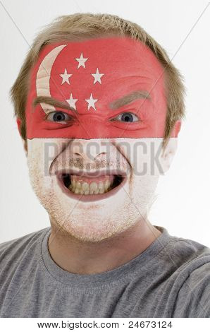 Face Of Crazy Angry Man Painted In Colors Of Singapore Flag