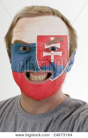 Face Of Crazy Angry Man Painted In Colors Of Slovakia Flag