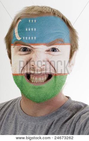 Face Of Crazy Angry Man Painted In Colors Of Uzbekistan Flag