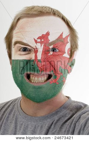 Face Of Crazy Angry Man Painted In Colors Of Wales Flag
