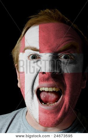 Face Of Crazy Angry Man Painted In Colors Of Denmark Flag