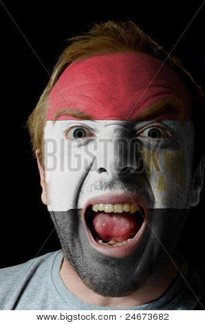 Face Of Crazy Angry Man Painted In Colors Of Egypt Flag