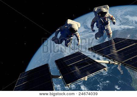 Astronauts in space around the solar battarei.