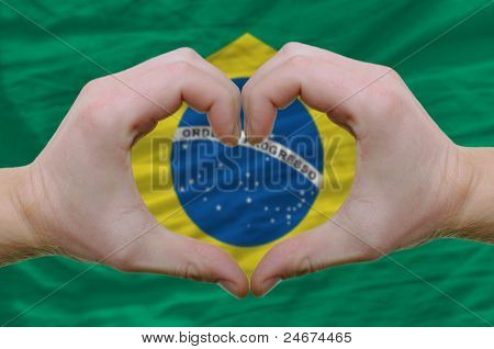 Heart And Love Gesture Showed By Hands Over Flag Of Brazil Background
