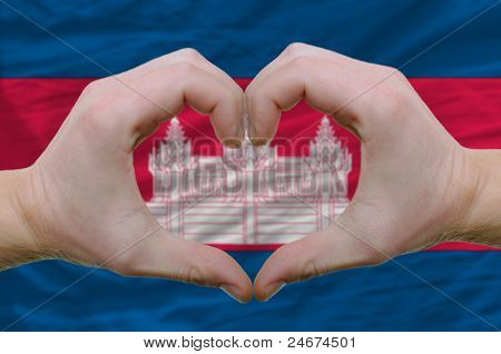 Heart And Love Gesture Showed By Hands Over Flag Of Cambodia Background