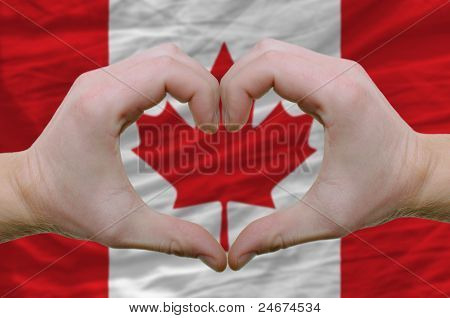 Heart And Love Gesture Showed By Hands Over Flag Of Canada Background