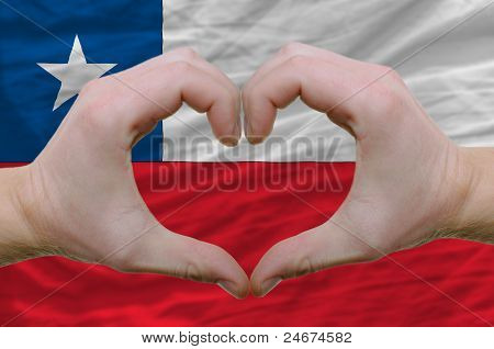 Heart And Love Gesture Showed By Hands Over Flag Of Chile Background