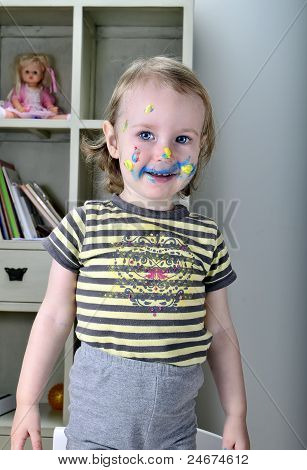 Little Girl And Colored Paints